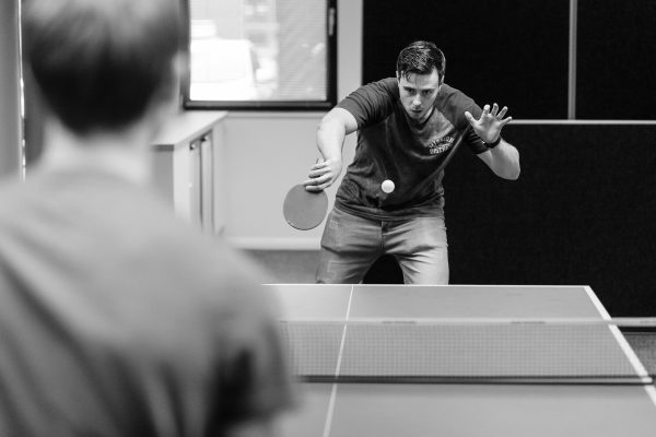 Mark Holland playing Table Tennis in Composite Profiles office