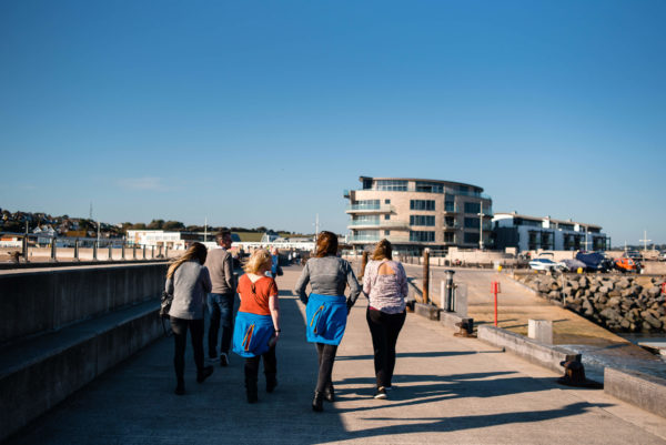 Staff at Composite Profiles enjoying a walking meeting in West Bay as part of their annual Building Excellence Day