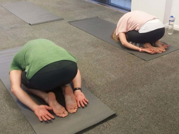 Child's Pose yoga in the office