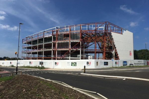 View from Boundary Roundabout of Bournemouth University's Poole Gateway Fusion Building before ComFlor CF51+ metal decking installed by Composite Profiles