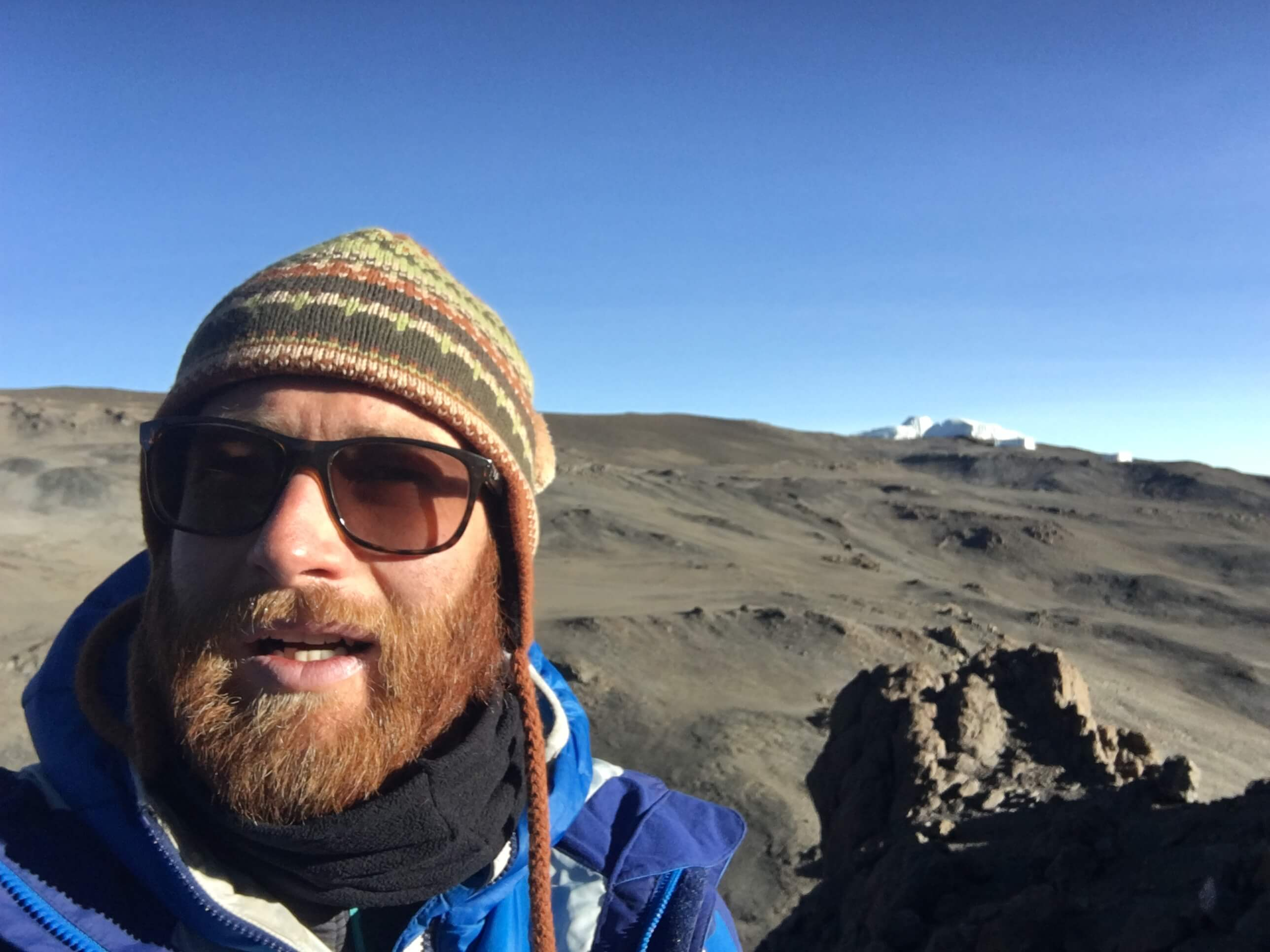 Selfie of Joel Nurser on Mount Kilimanjaro glacier raising money for Marie Curie charity