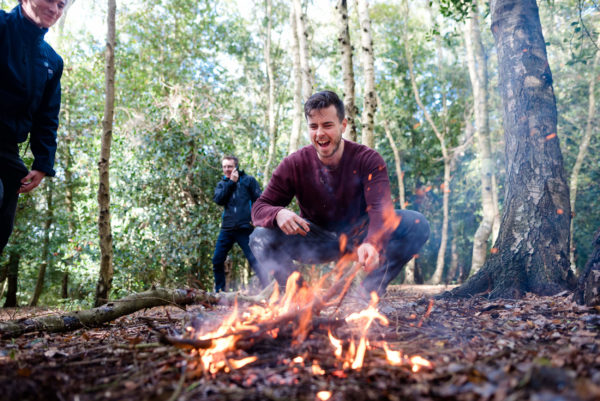 Mark Holland mastering fire making in the woods
