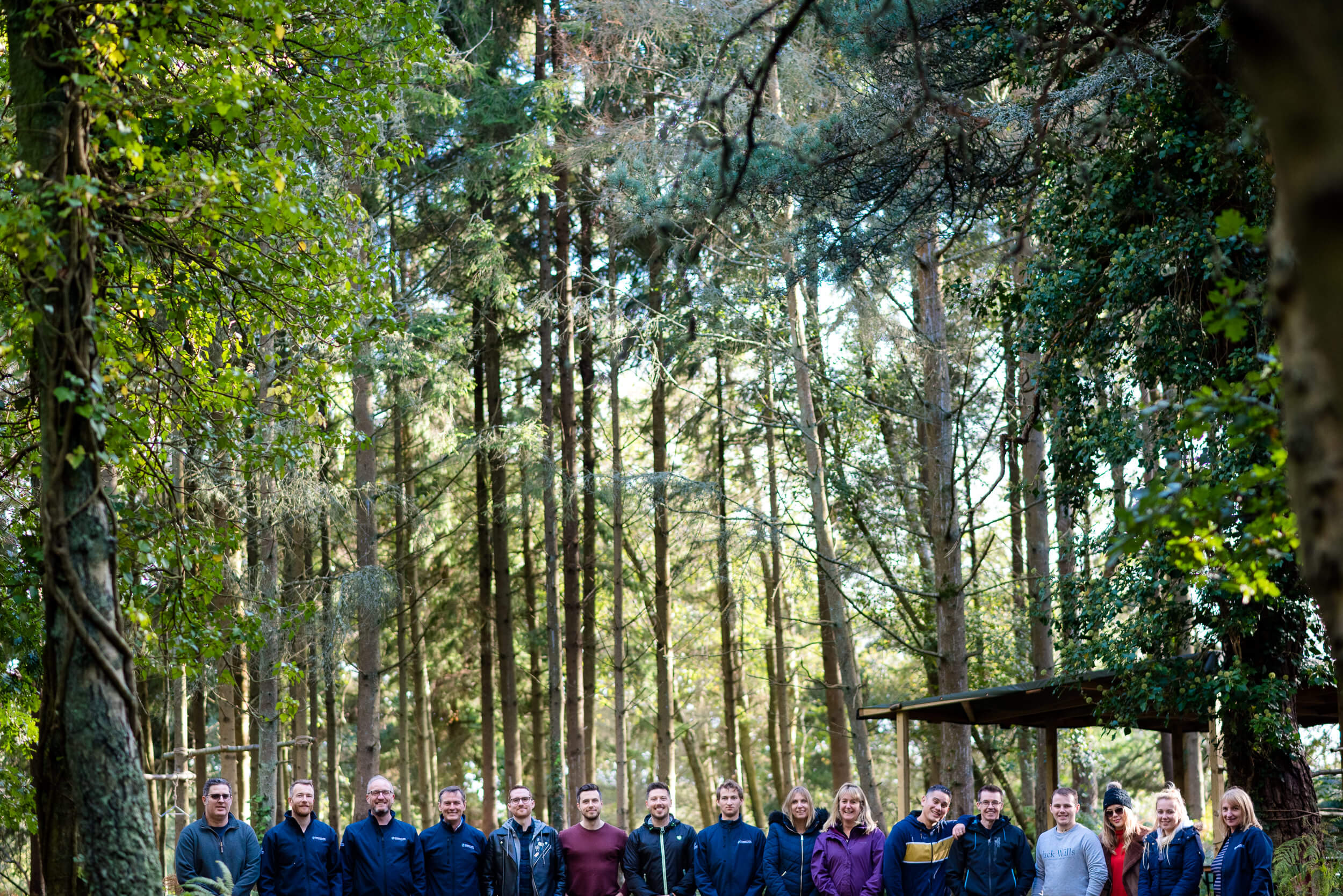 Composite Profiles enjoying teambuilding activities in the woods with Land & Wave Outdoor Adventure