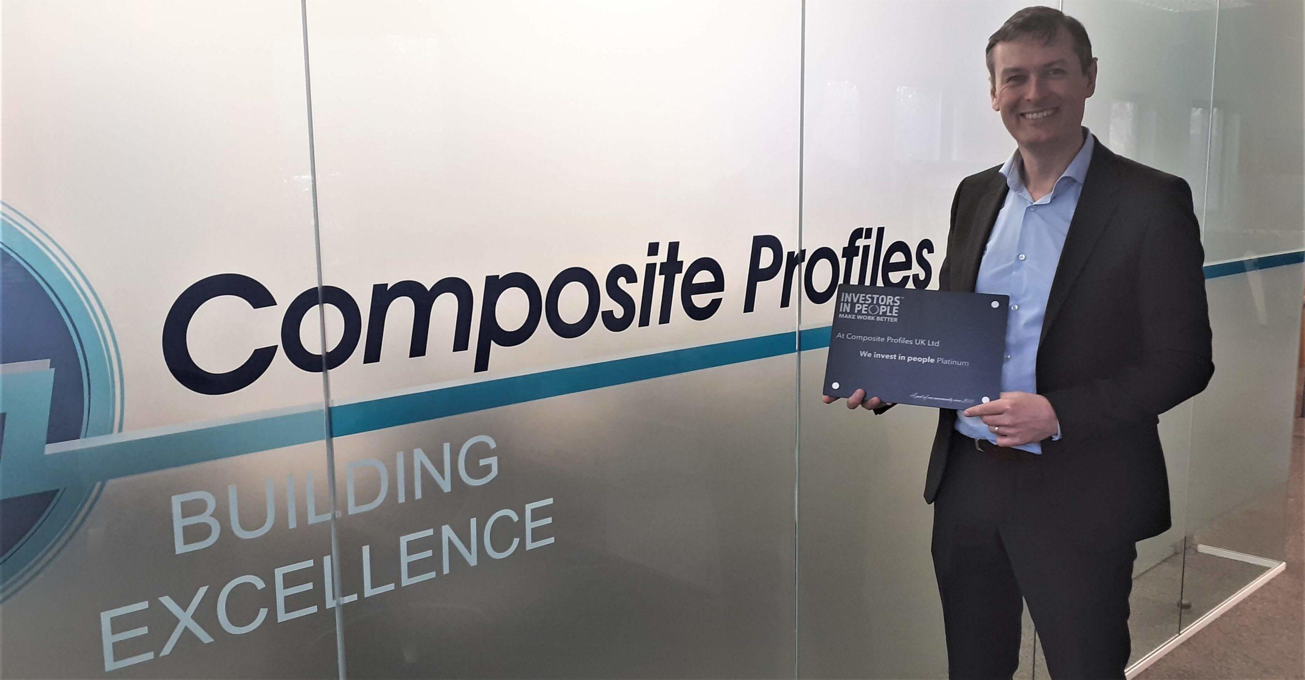 Mark Norton holding We Invest in People Platinum Award